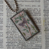 Butterfly, feather, vintage children's book illustration, upcycled to soldered glass pendant
