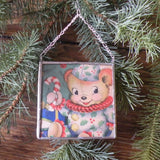 Girl and teddy bear, vintage 1950s -1960s Christmas card, upcycled to hand-soldered glass Christmas tree ornament