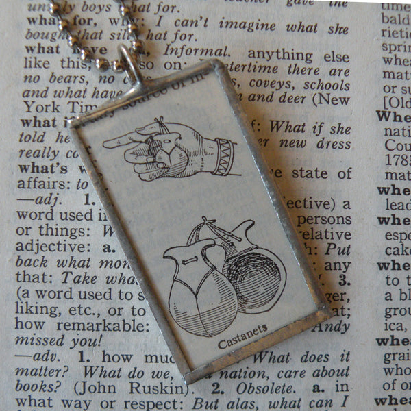 Castanets, vintage dictionary illustration up-cycled to soldered glass pendant