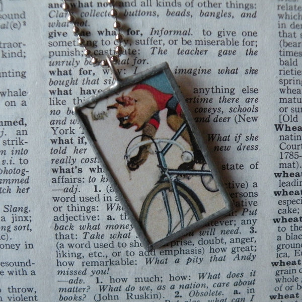 Cat on a bicycle, vintage illustrations upcycled to soldered glass pendant