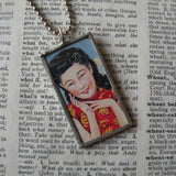 Chinese woman and golden bat, vintage fireworks packaging illustration, upcycled to soldered glass pendant