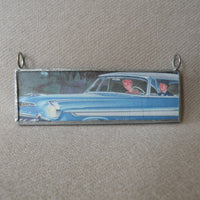 Vintage 1950s automobile advertisement, mid-century modern illustration upcycled to soldered glass pendant
