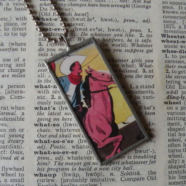 Cowboy on horseback, vintage fireworks packaging illustration, hand-soldered glass pendant, choice of necklace, bookmark or keychain
