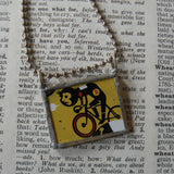 Bicyclist, bicycle, vintage mid-century modern illustration up-cycled to hand-soldered glass pendant