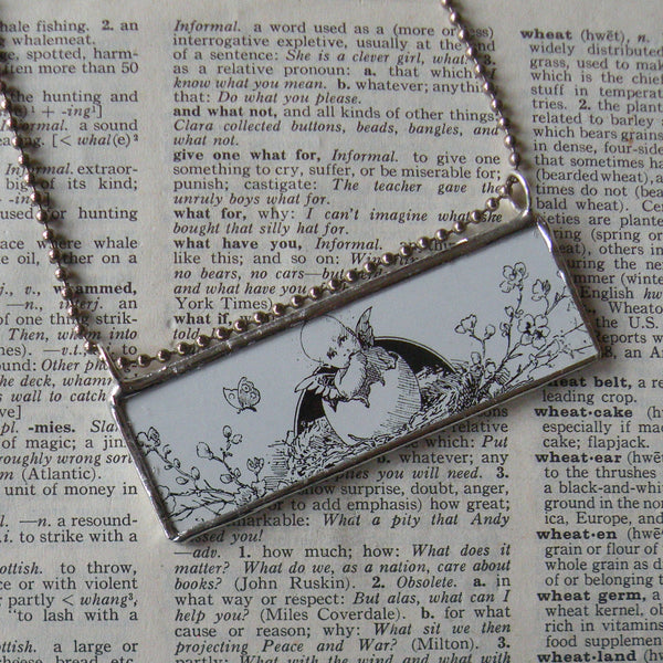Baby angel in bird's nest, vintage Easter illustration, upcycled to soldered glass pendant