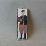 Drummer, musician, folk art painting, upcycled to soldered glass pendant