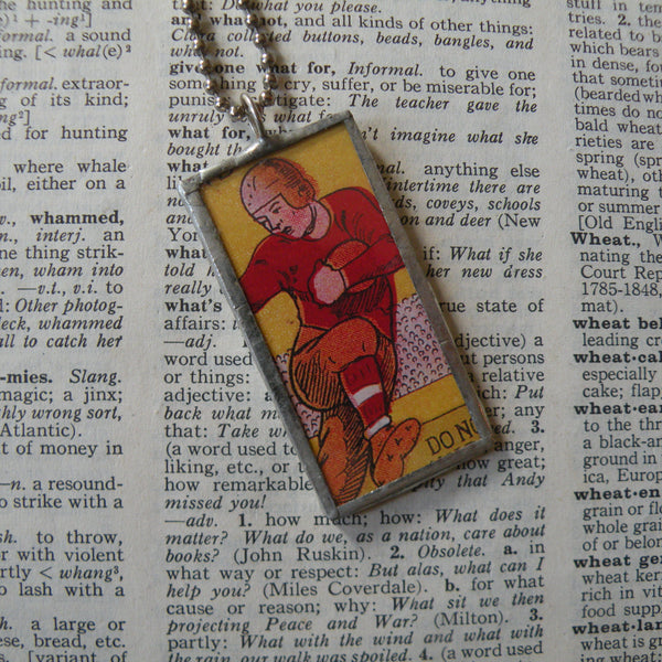 Vintage football player, vintage illustration from fireworks packaging, soldered glass pendant