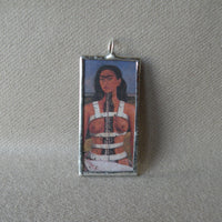 Frida Khalo, self-portrait and portrait of elder, upcycled to hand soldered glass pendant