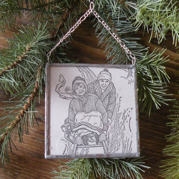 1Children sledding, holiday greeting, vintage 1950s - 60s Christmas cards, upcycled to hand-soldered glass Christmas tree ornament