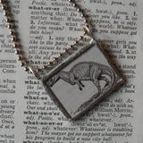 Tyrannosaurus T-Rex Dinosaur, vintage dictionary black and white illustration upcycled to soldered glass pendant