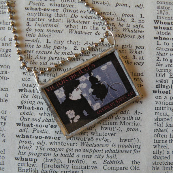 Vintage bicycle advertisement, vintage illustration, up-cycled to soldered glass pendant