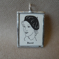 Woman in French beret, vintage dictionary illustration, upcycled to soldered glass pendant
