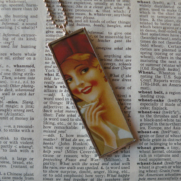 Woman, pink tutu, red beret, vintage tobacco advertising illustration, upcycled to soldered glass pendant
