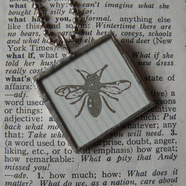 House fly and blackberry leaves, letterpress illustrations, upcycled to soldered glass pendant
