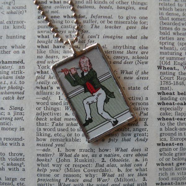 Leprechaun playing flute, vintage illustration, upcycled to soldered glass pendant