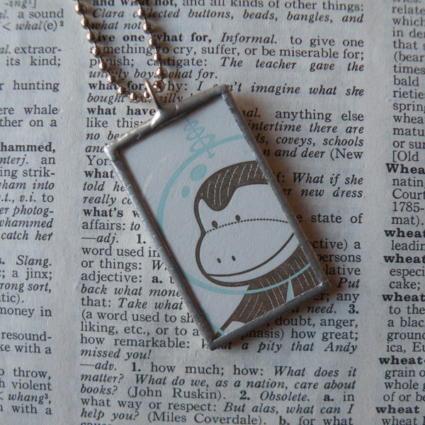 Sock Monkey, space helmet and alien, vintage greeting card upcycled to soldered glass pendant