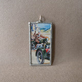 Vintage motorcycle advertising illustration, upcycled to hand-soldered glass pendant