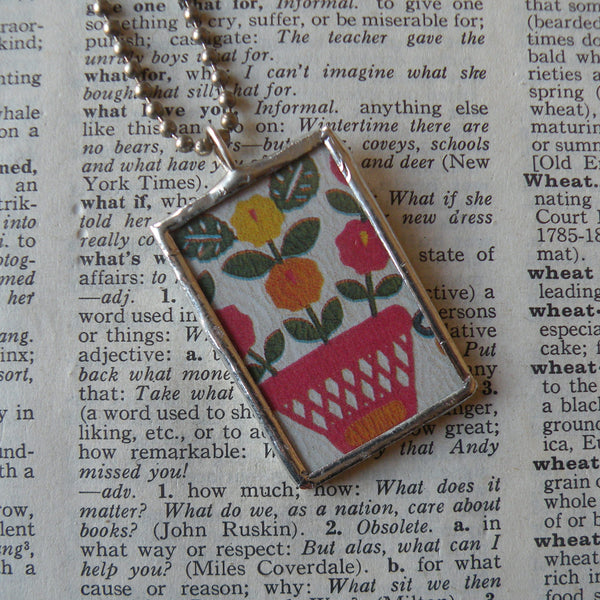 Antique quilt with floral and berry designs, American folk art image upcycled to 2-sided hand soldered glass pendant