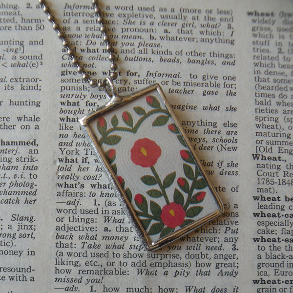 Antique quilt with florad design, American folk art image upcycled to 2-sided hand soldered glass pendant