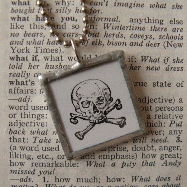 Skull and crossbones illustration, up-cycled to 2-sided, soldered glass pendant