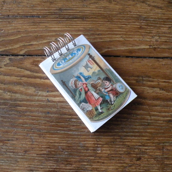 Antique sewing advertising trade card,  up-cycled to wire-bound sketchbook / journal