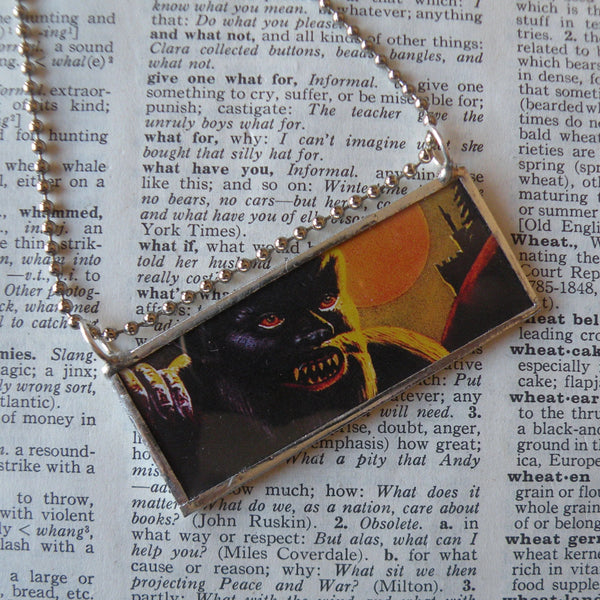 Werewolf, vintage fireworks packaging graphics illustrations, upcycled to soldered glass pendant