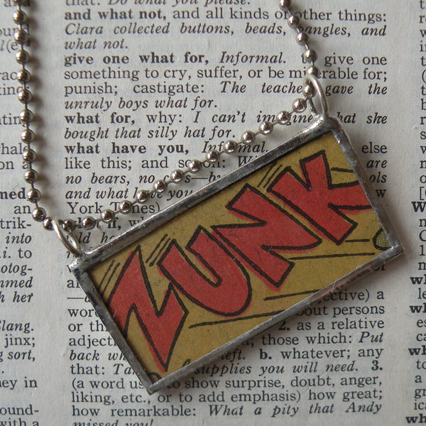 ZUNK, onomatopoeia, vintage comic book illustration, upcycled to soldered glass pendant
