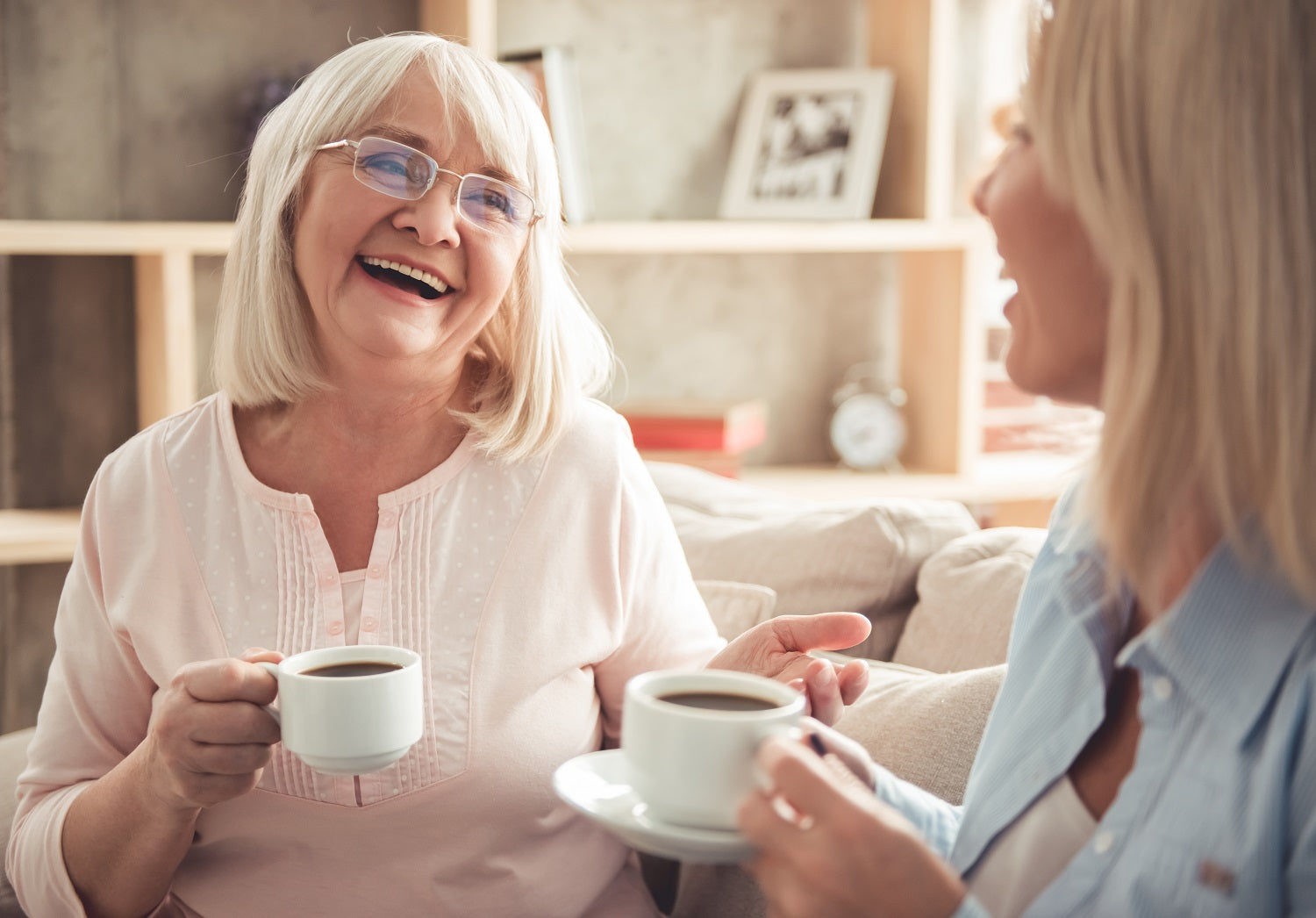 Older woman laughing with daughter