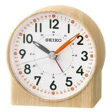 SEIKO BEDSIDE ALARM CLOCK BEIGE WHITE DIAL WITH ORANGE INDEXES