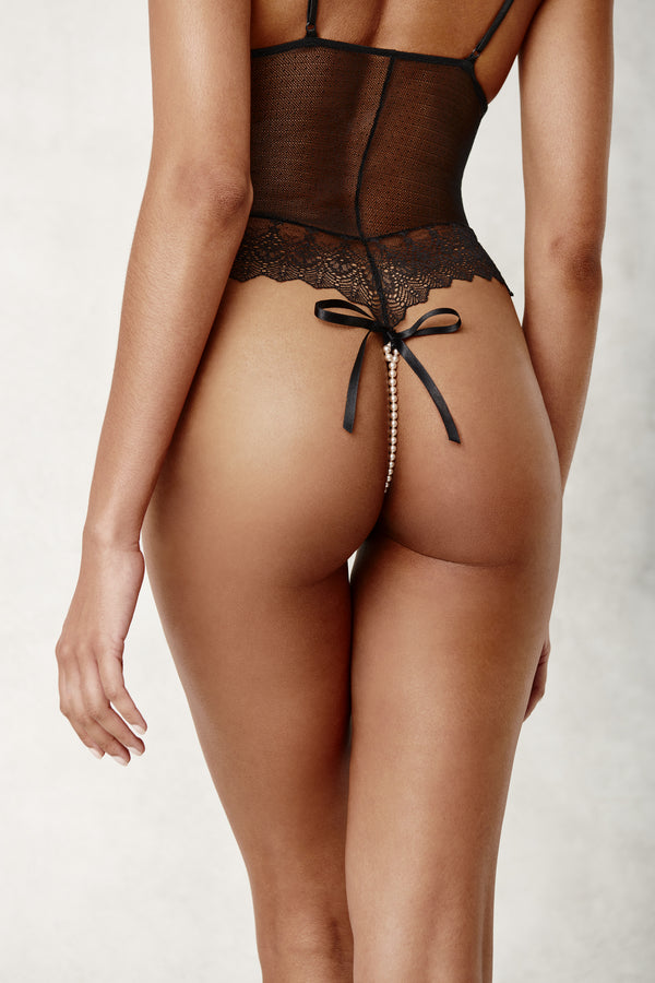 Back view of black lace and mesh Geneva Body suit with pearl thong