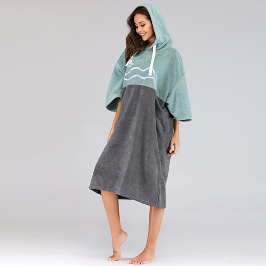 Blue microfibre beach poncho shown on female model