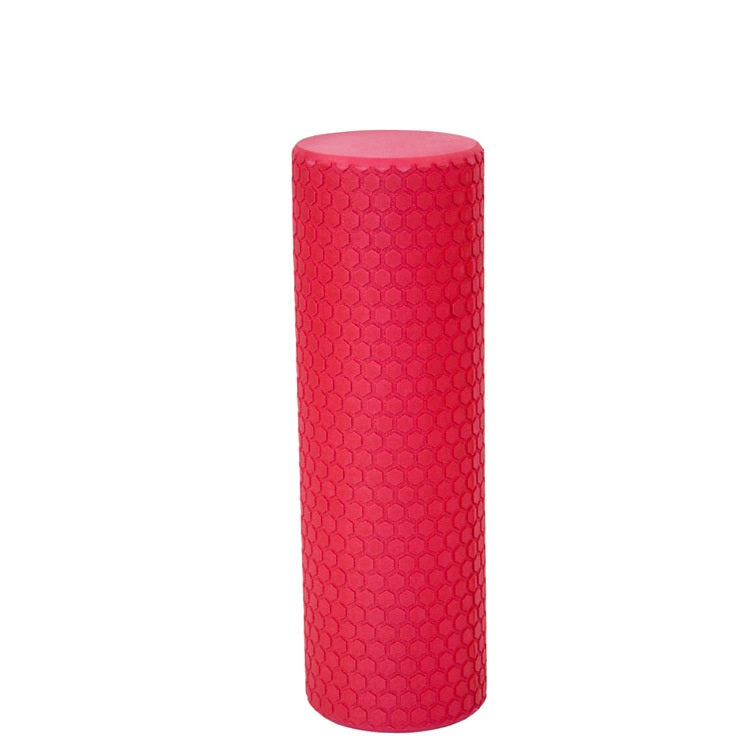 Pink foam roller on white background