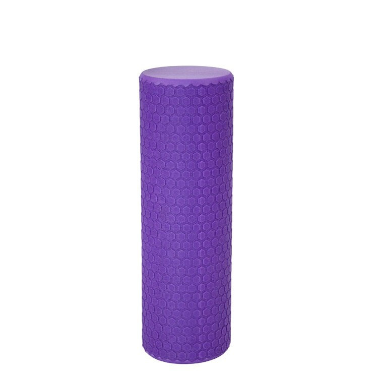 Purple foam roller on white background
