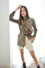 Olive safari jacket on model styled with cream shorts