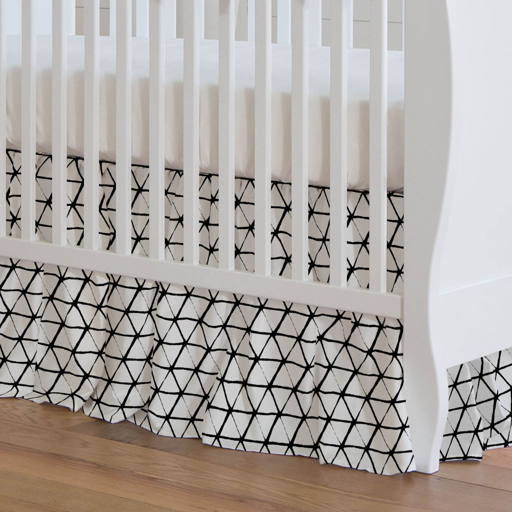 Product image for White and Onyx Aztec Triangles Crib Skirt Gathered