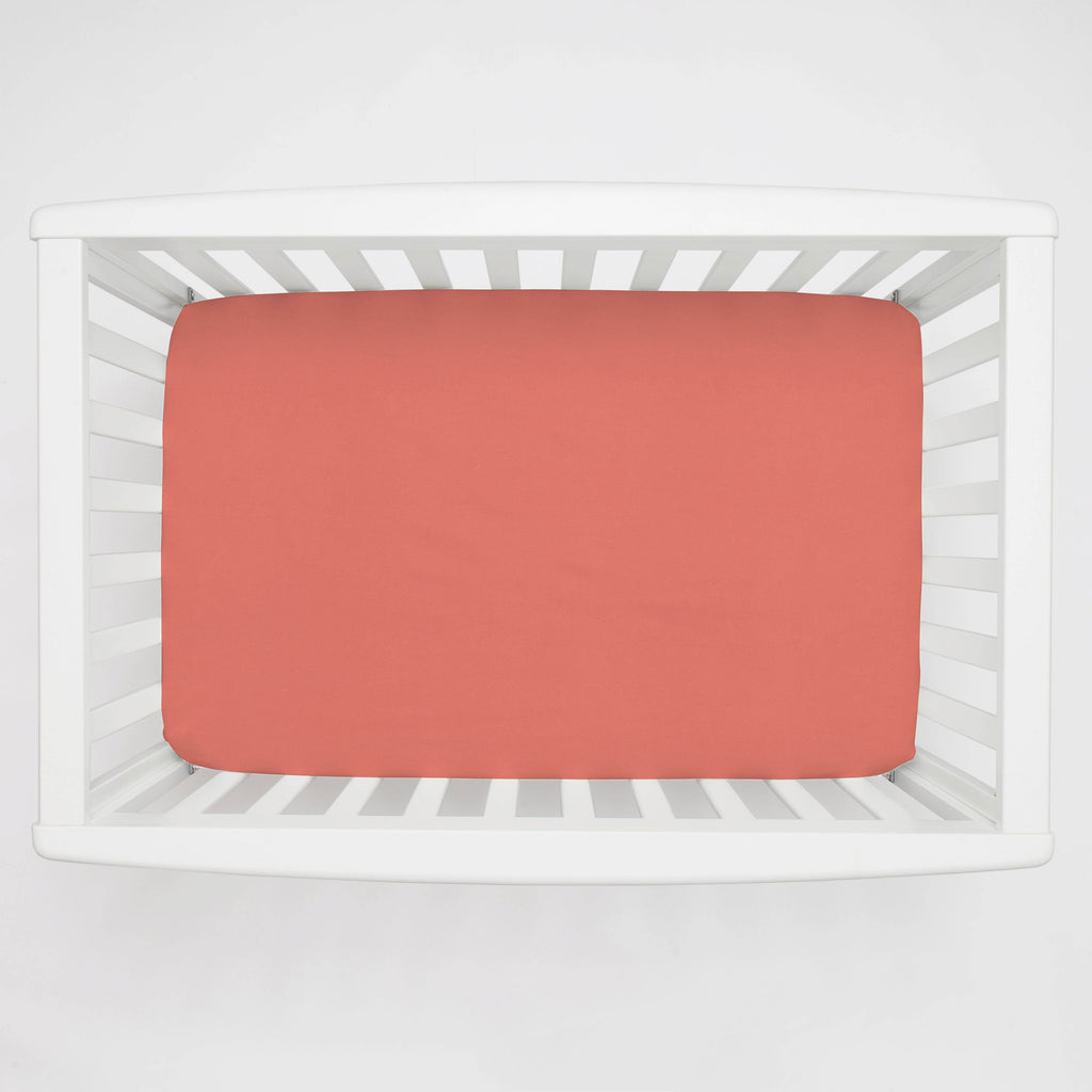 Product image for Solid Coral Mini Crib Sheet