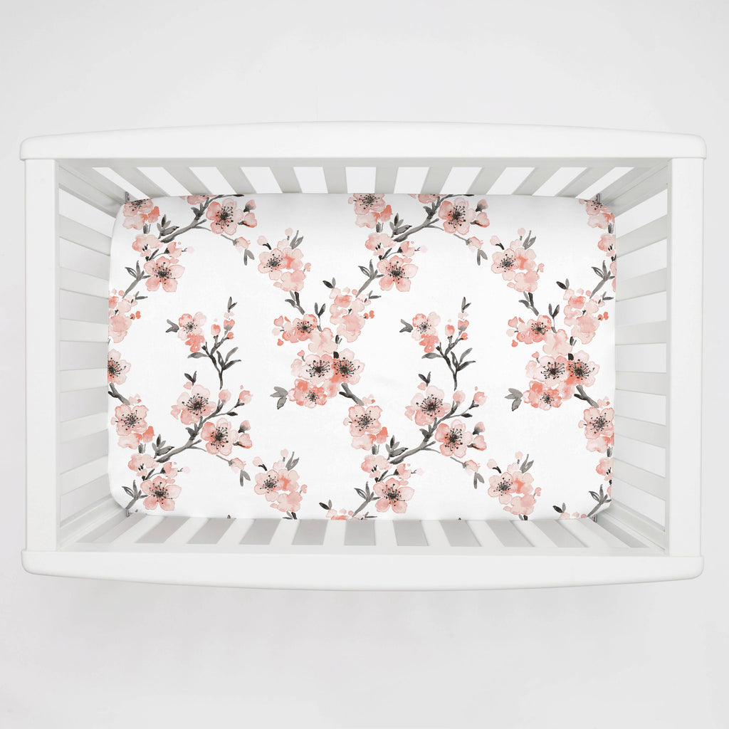 Product image for Light Coral Cherry Blossom Mini Crib Sheet
