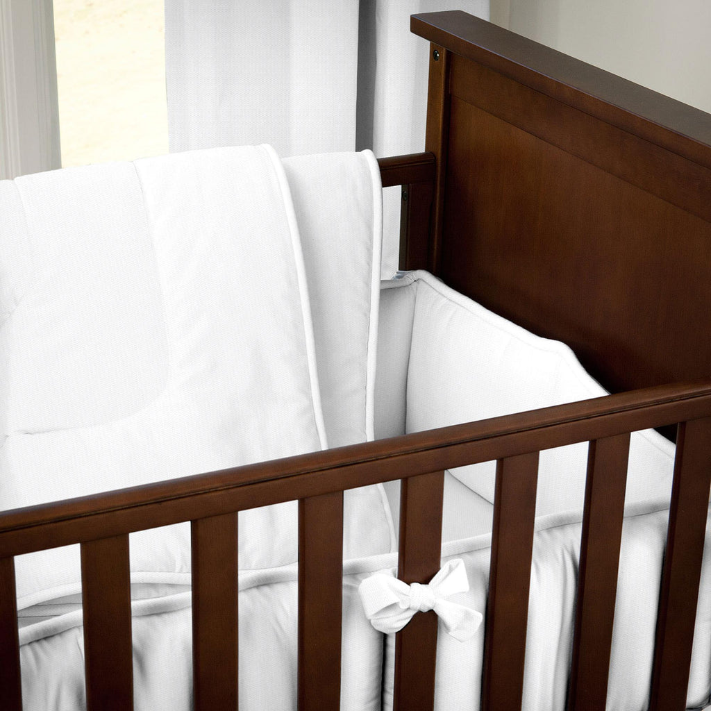 Product image for White Pique Crib Comforter with Piping