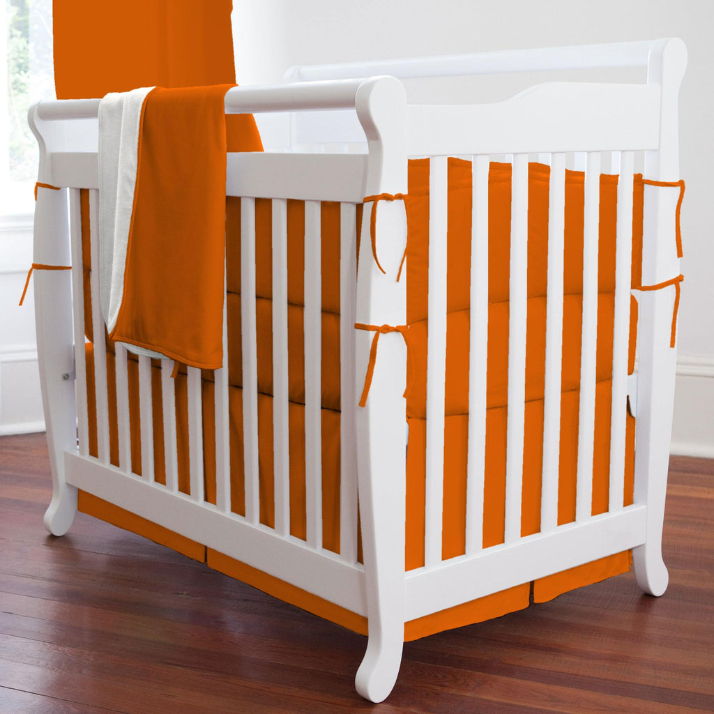 Product image for Solid Orange Mini Crib Skirt