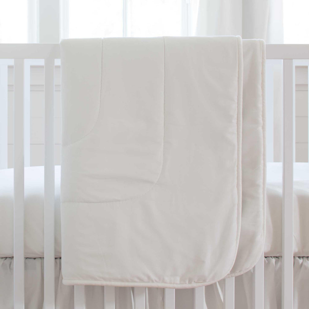 Product image for Solid White Crib Comforter with Piping