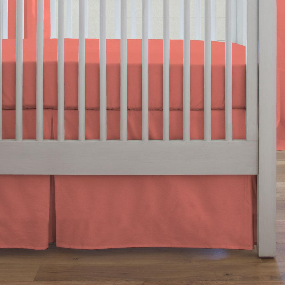 Product image for Solid Coral Crib Skirt