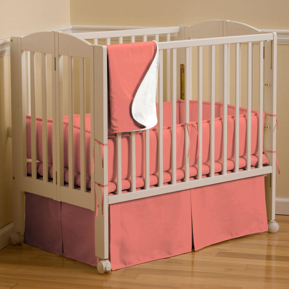 Product image for Solid Coral Mini Crib Skirt