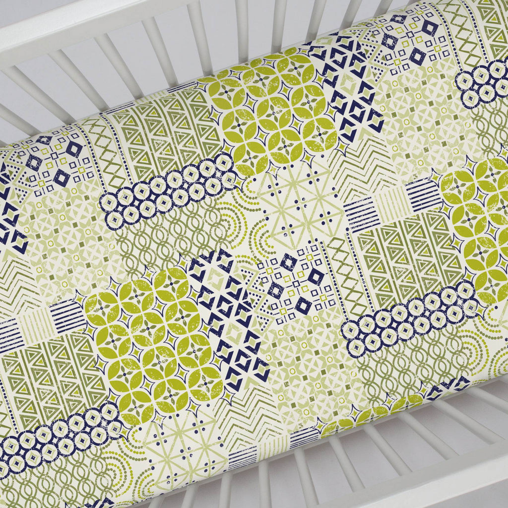 Product image for Citron and Navy Patchwork Crib Sheet
