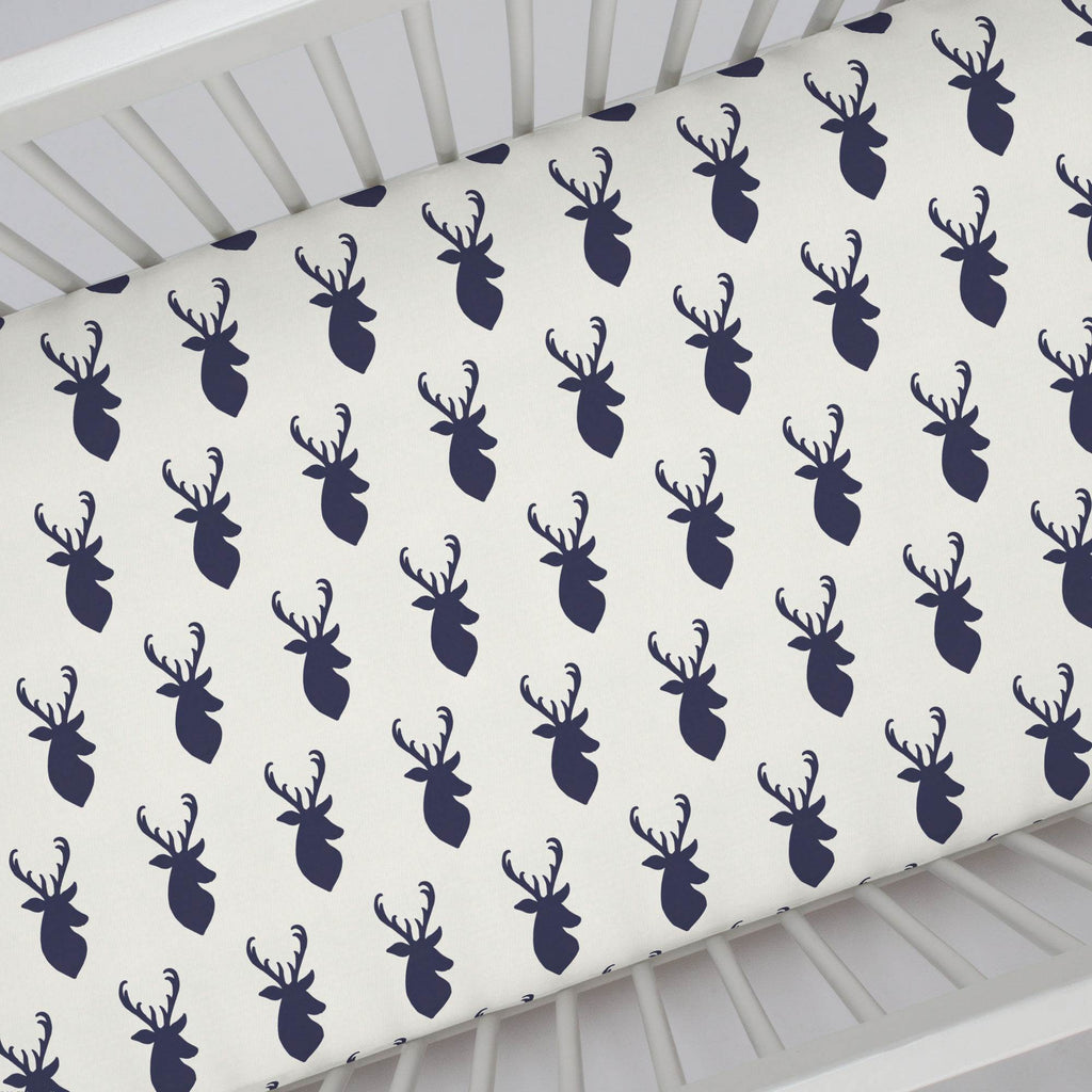 Product image for Windsor Navy Deer Head Crib Sheet