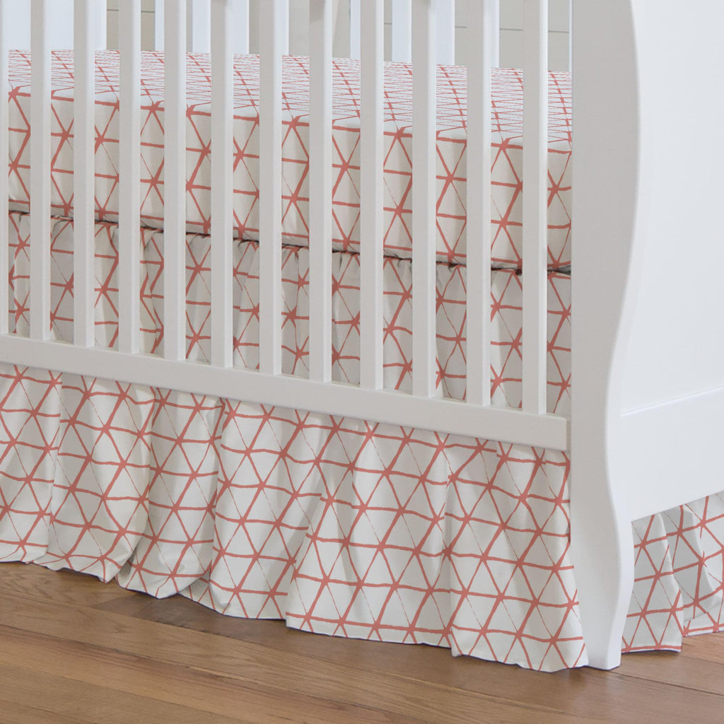 Product image for White and Light Coral Aztec Triangles Crib Skirt Gathered
