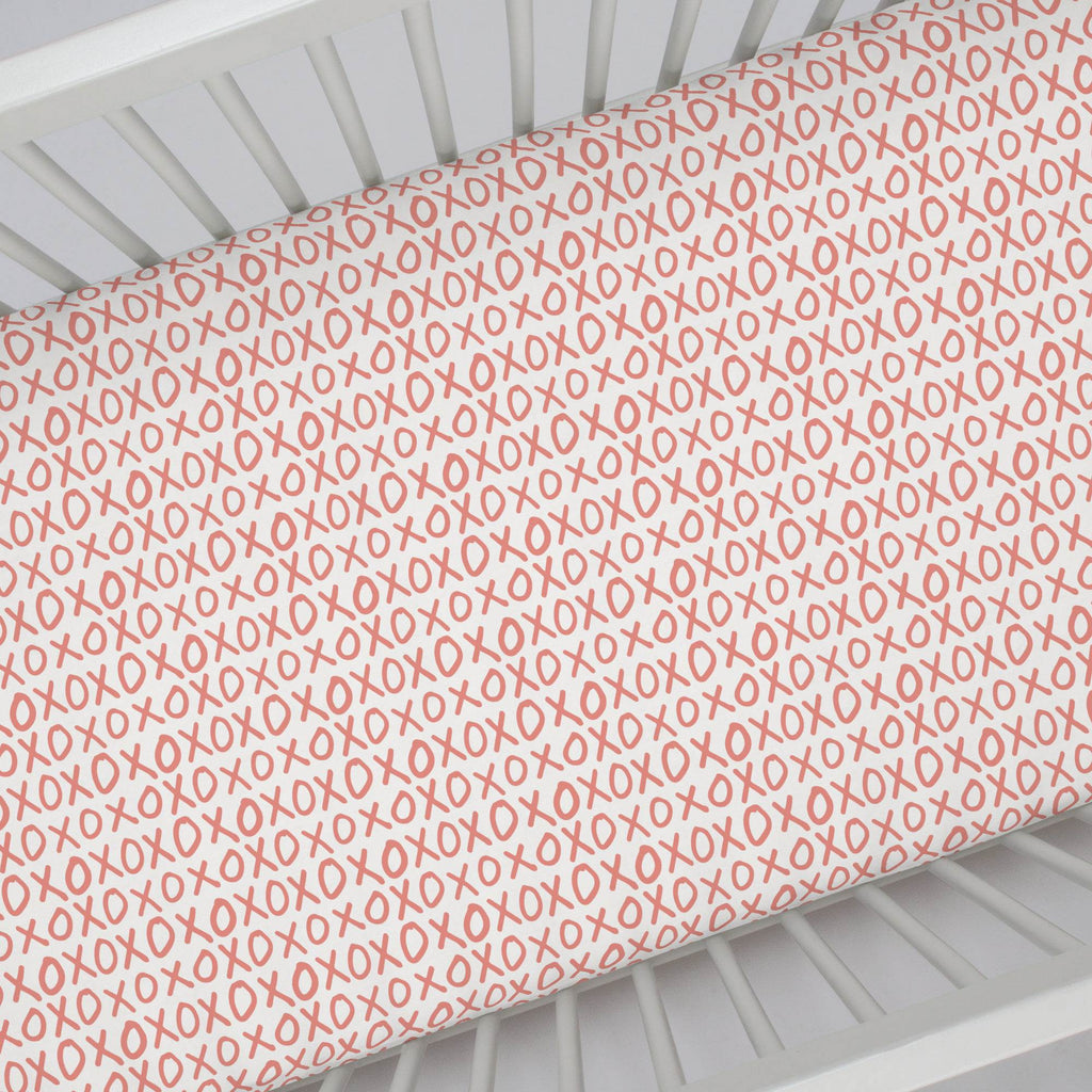 Product image for Light Coral XO Crib Sheet