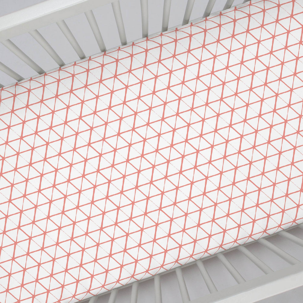 Product image for White and Light Coral Aztec Triangles Crib Sheet
