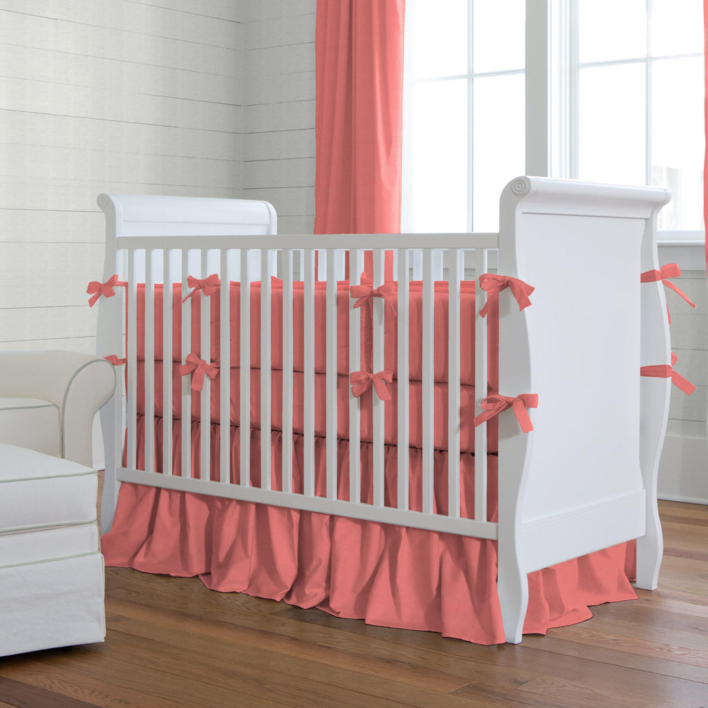 Product image for Solid Coral Crib Comforter with Piping