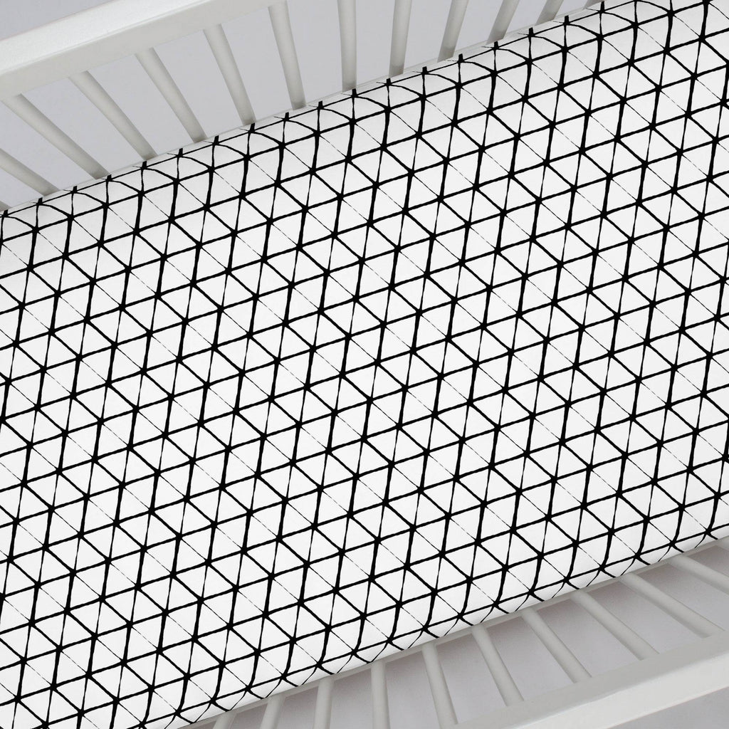 Product image for White and Onyx Aztec Triangles Crib Sheet