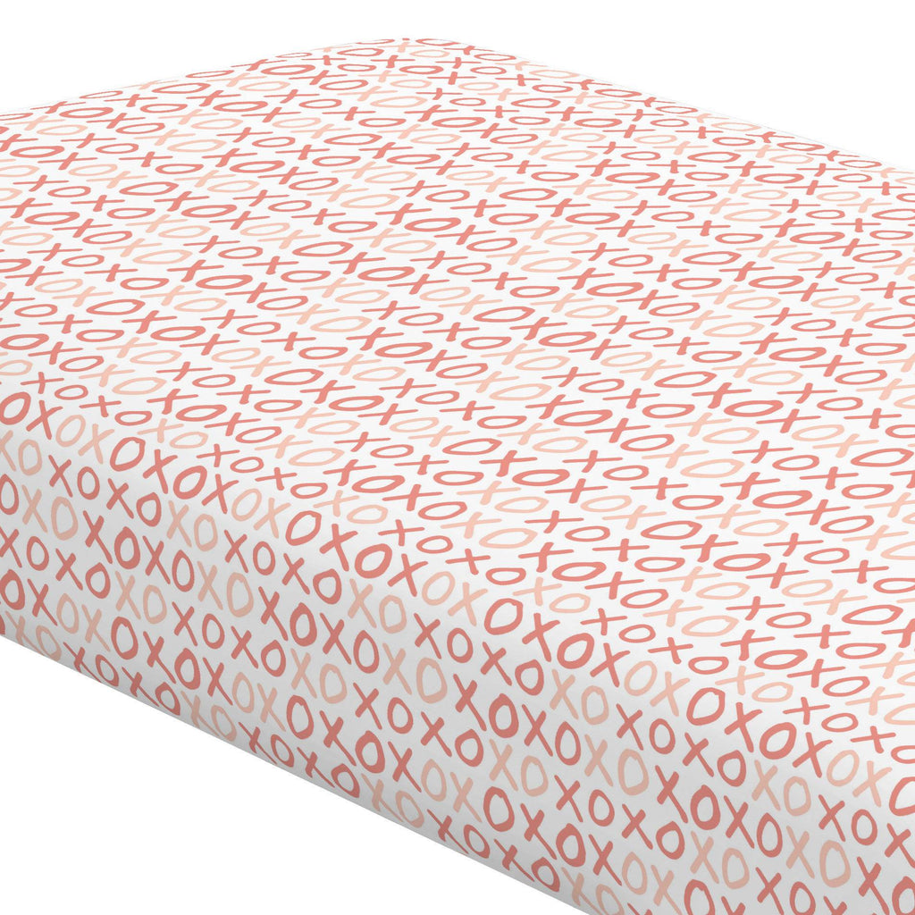 Product image for Light Coral and Peach XO Crib Sheet